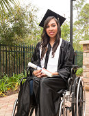Vertical image of young Hispanic graduate in wheelchair